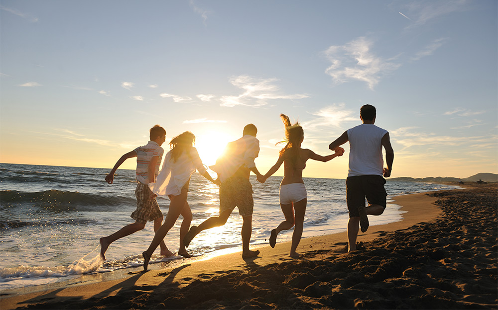 polyamorous polycule running on the beach